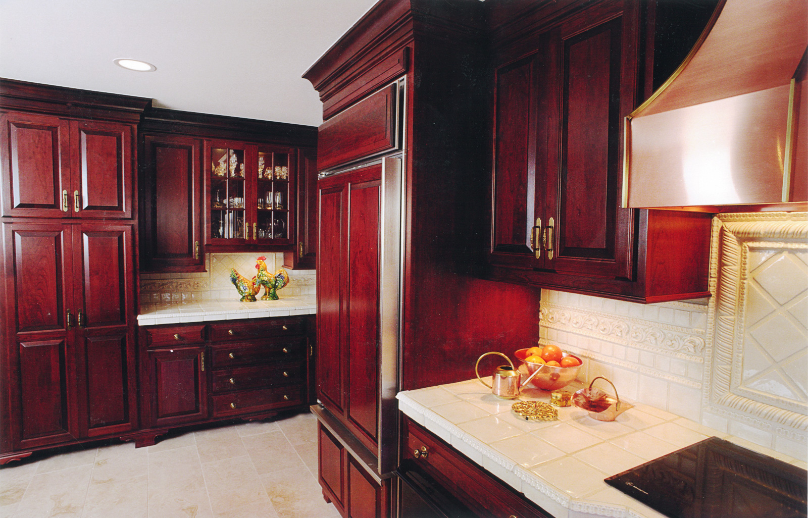 Side view of Custom Cherrywood Kitchen with paneled refrigerator and walls.